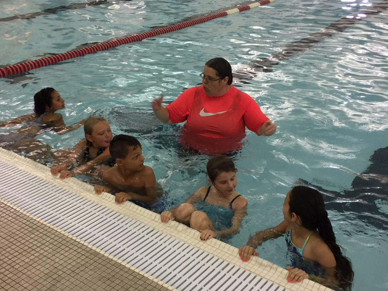Group of students in the pool with an instructor.
